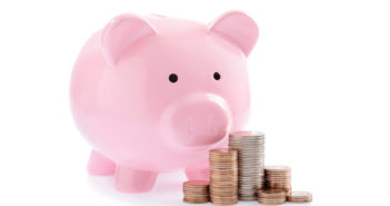 Pink piggy bank and Stacks of money coins